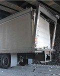 Truck Stuck Under Bridge