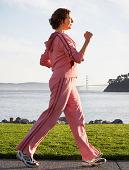 Woman Walking in Tracksuit along coast