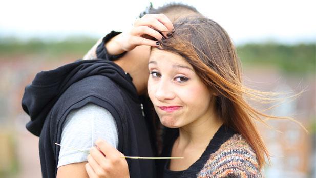 romance break up - girl looking perplexed during a hug