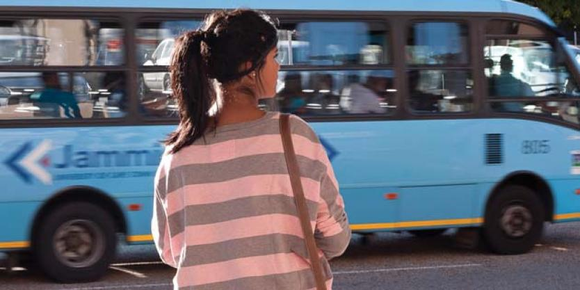 uct jammie shuttle bus whizzing past a female student