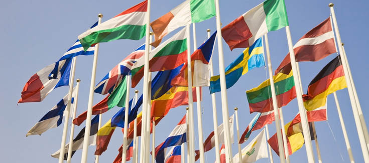 internationalization many flags of the world flapping in the wind