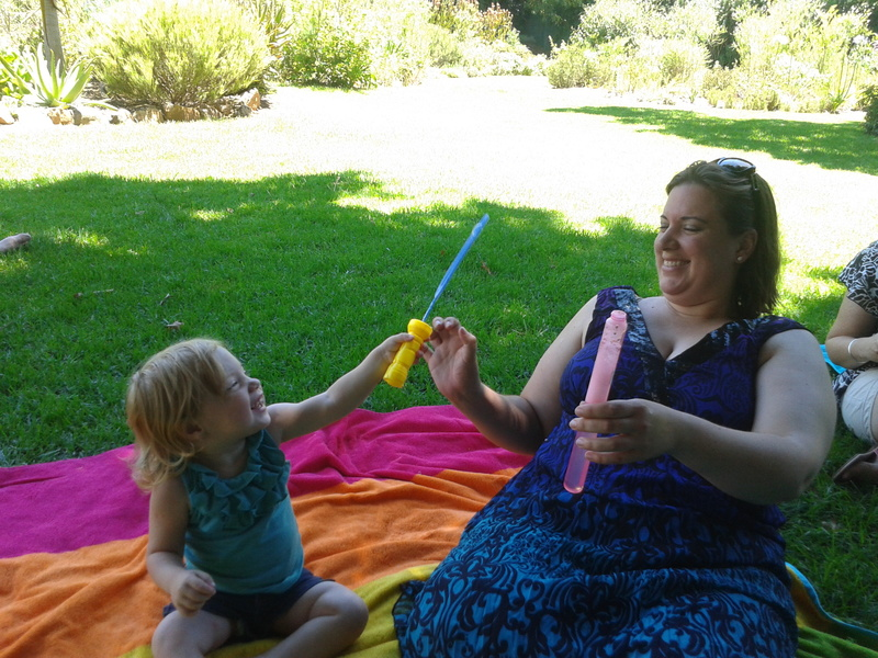 chantelle lotter and jessica lotter toddler playing with bubbles