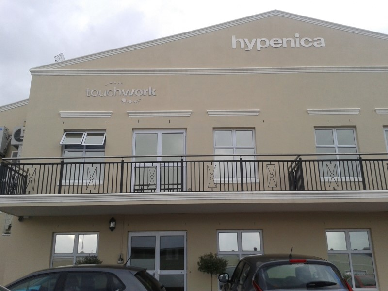 touchwork and hypenica logos up on building at last