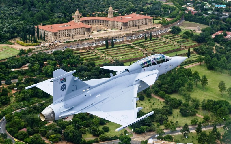 Saab JAS 39 Gripen fighter jet flying over Union Buildings in Pretoria South Africa