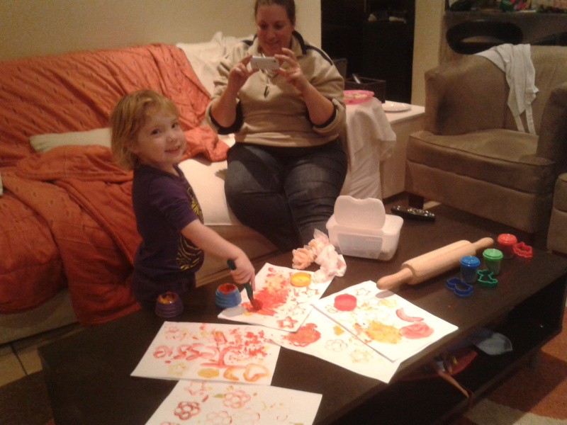 jessica and chantelle painting in the lounge