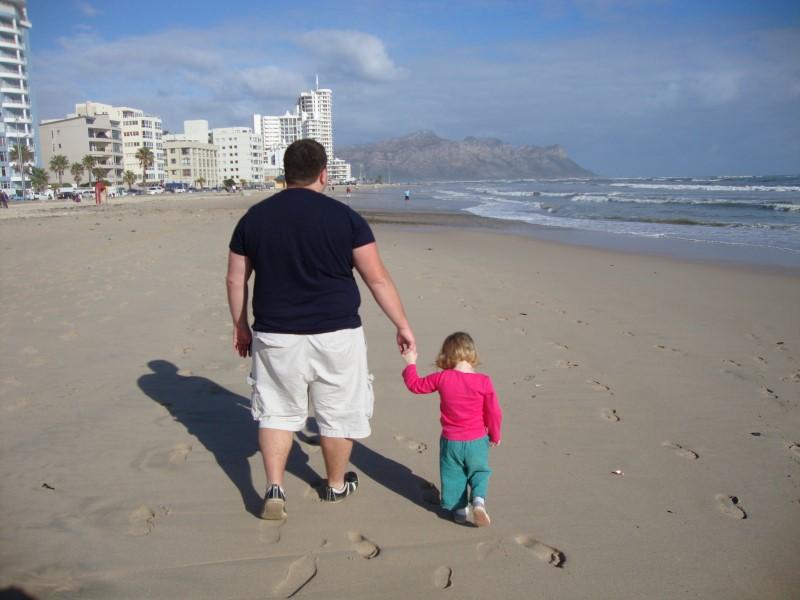 craig lotter walking with jessica along strand beach