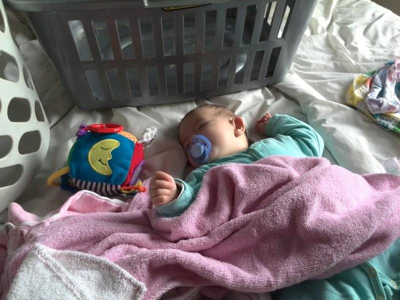 baby emily lotter sleeping amongst the washing 2