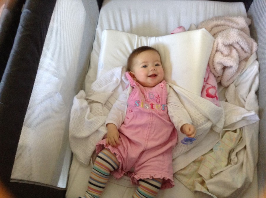 emily lotter in her cot at baby steps