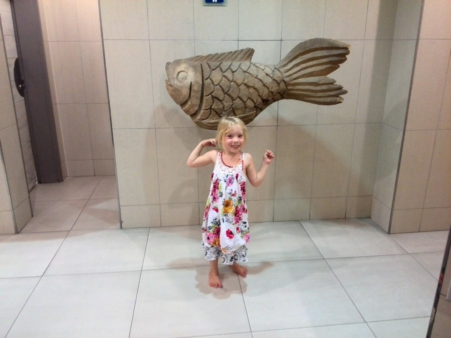 IMG_20150207_154806 jessica lotter and a wooden fish statue in the weskus mall