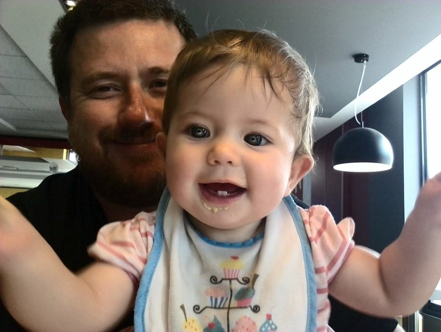 baby emily lotter smiling with daddy craig lotter