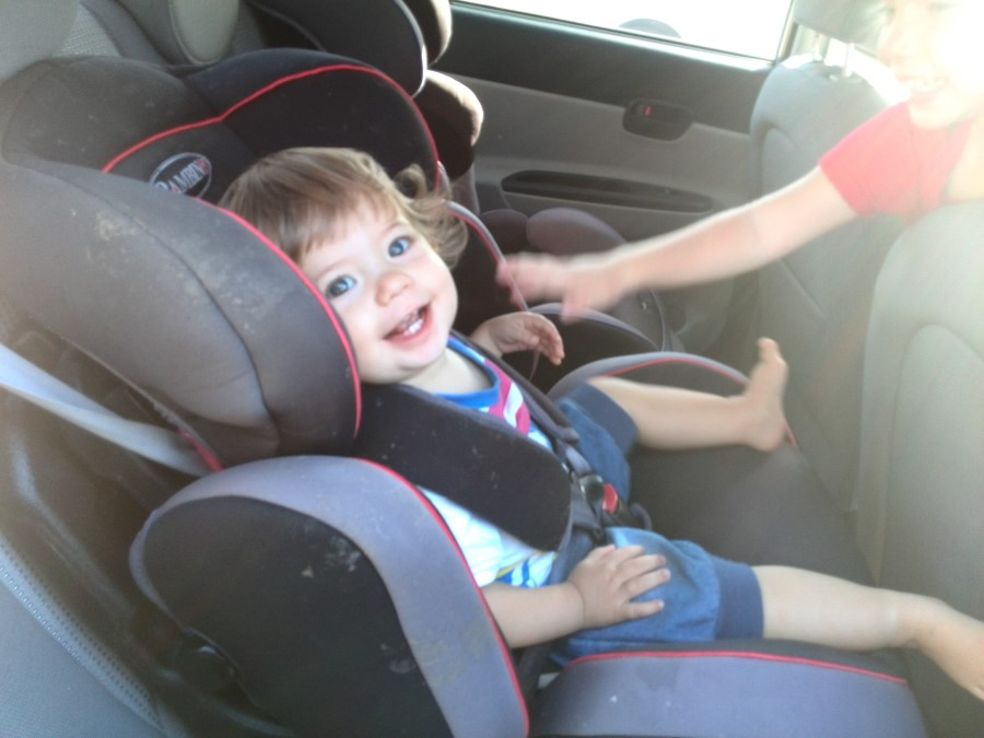 emily lotter sitting in the bambino roadster car seat