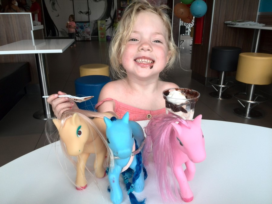 jessica lotter with her ponies and a mcdonald chocolate sundae