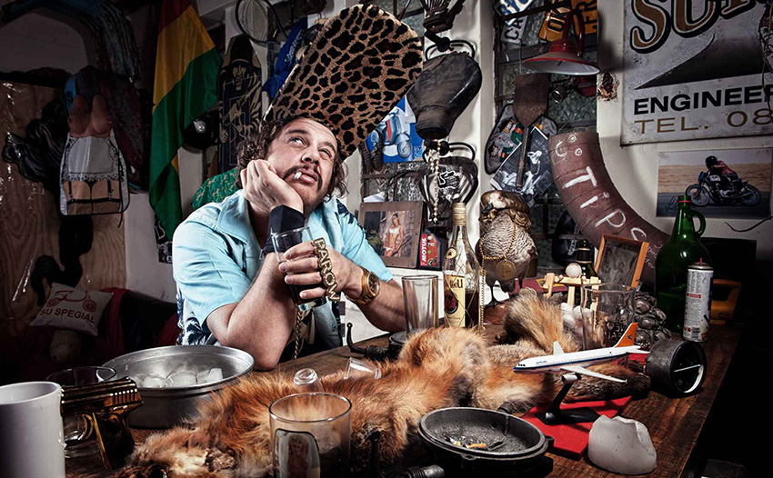 south african afrikaans rapper jack parow sitting at the bar