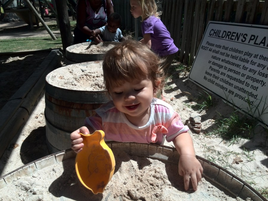 IMG_20150307_124224 toddler emily lotter playing in the sand at root 44 market