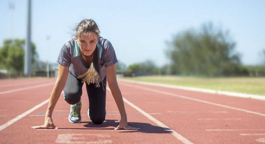 lady setting up to run on a track