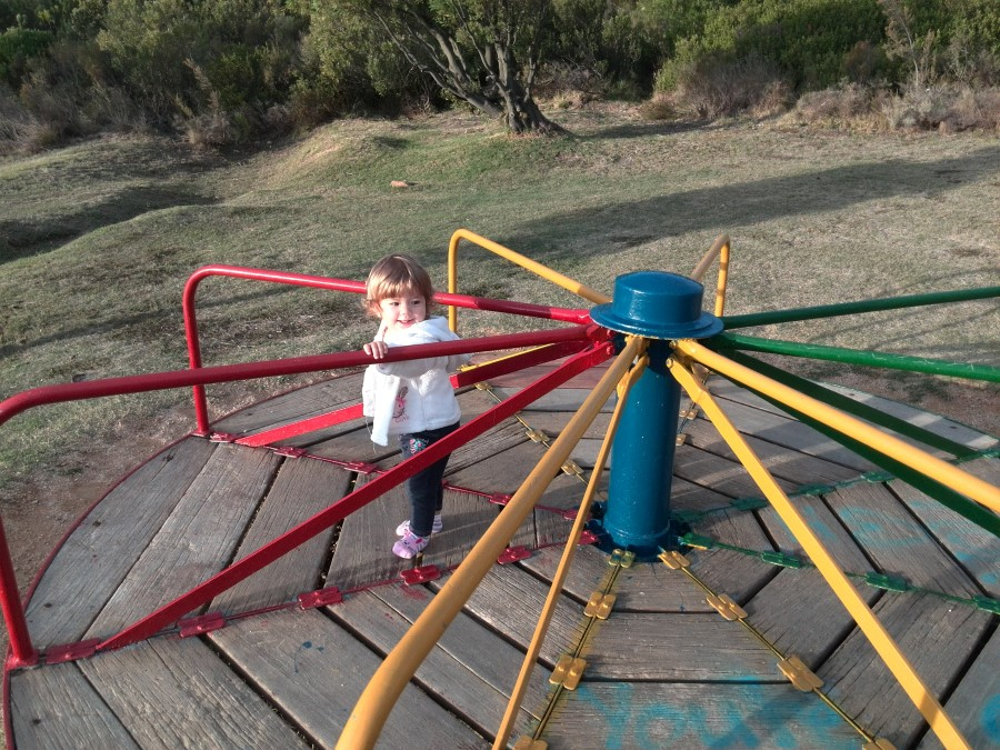 IMG_20150505_171533 little girl emily lotter on the merry-go-round
