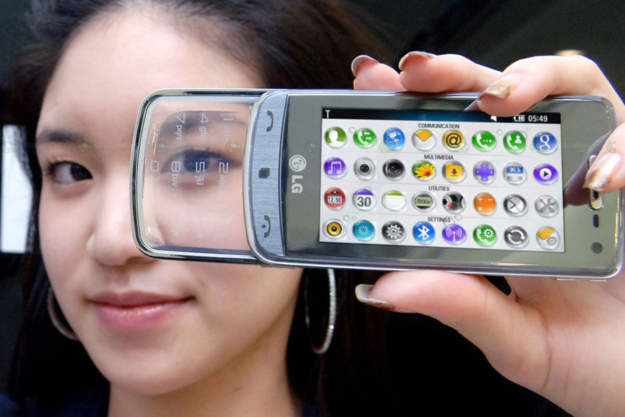 girl holding a cell phone on its side - LG GD900 transparent phone