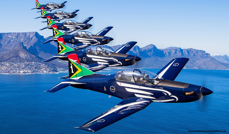 saaf silver falcons flying in formation in cape town over the sea and in front of the mountain