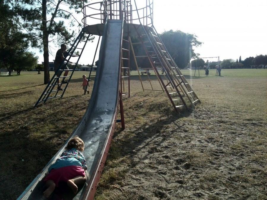 baby emily lotter tackling the big slide in oakglen's park