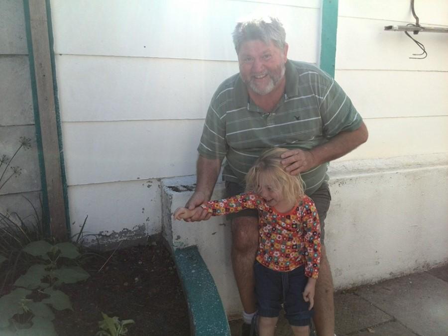 grandpa monty montgomery standing with jessica lotter next to her bean garden