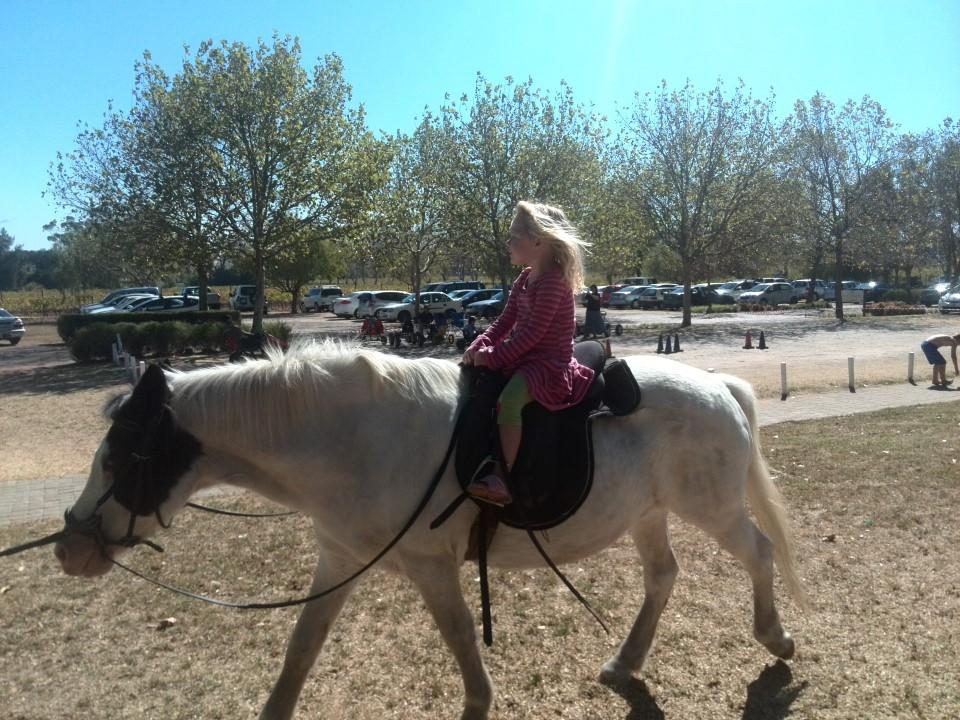 IMG_20150412_134211 jessica riding a pony at blaauwklippen family market
