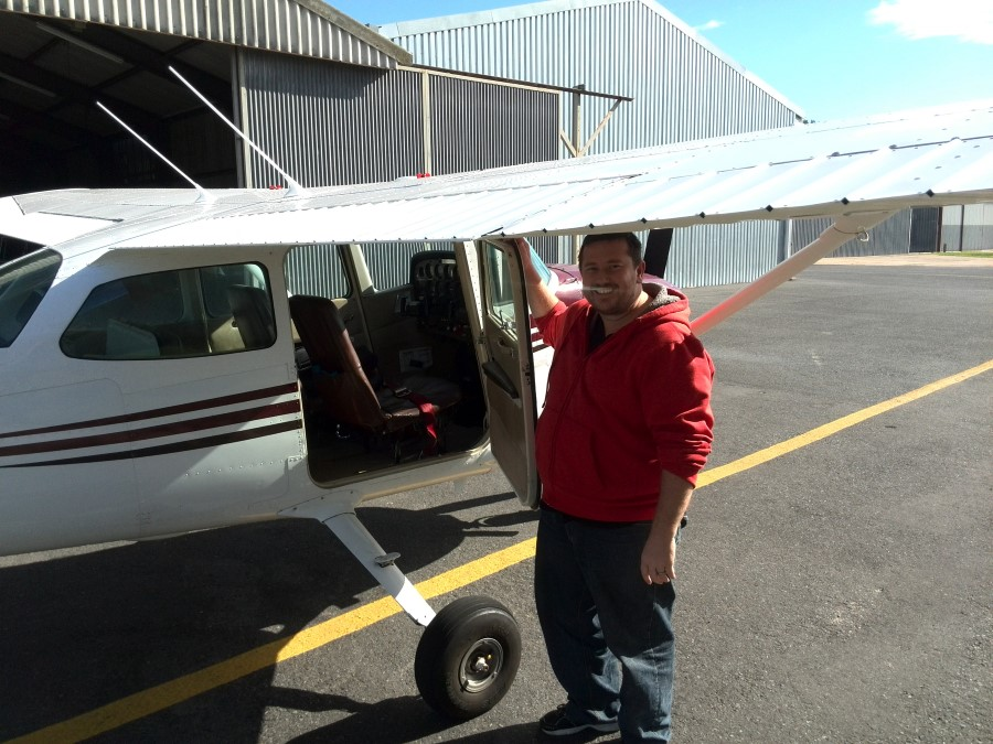 IMG_20150606_124240 craig lotter standing next to the stellenbosch flying club cessna 172 - ZS-SLM he just flew in 1