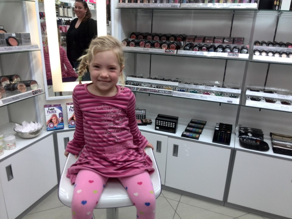 IMG_20150620_120548 jessica lotter getting her ears pierced at ralo cosmetics in the helderberg centre shopping mall