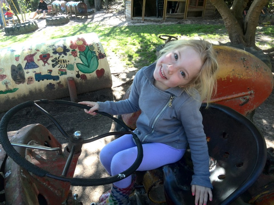 IMG_20150810_114612 jessica lotter on a tractor at the kids play area at helderberg farm on the R44