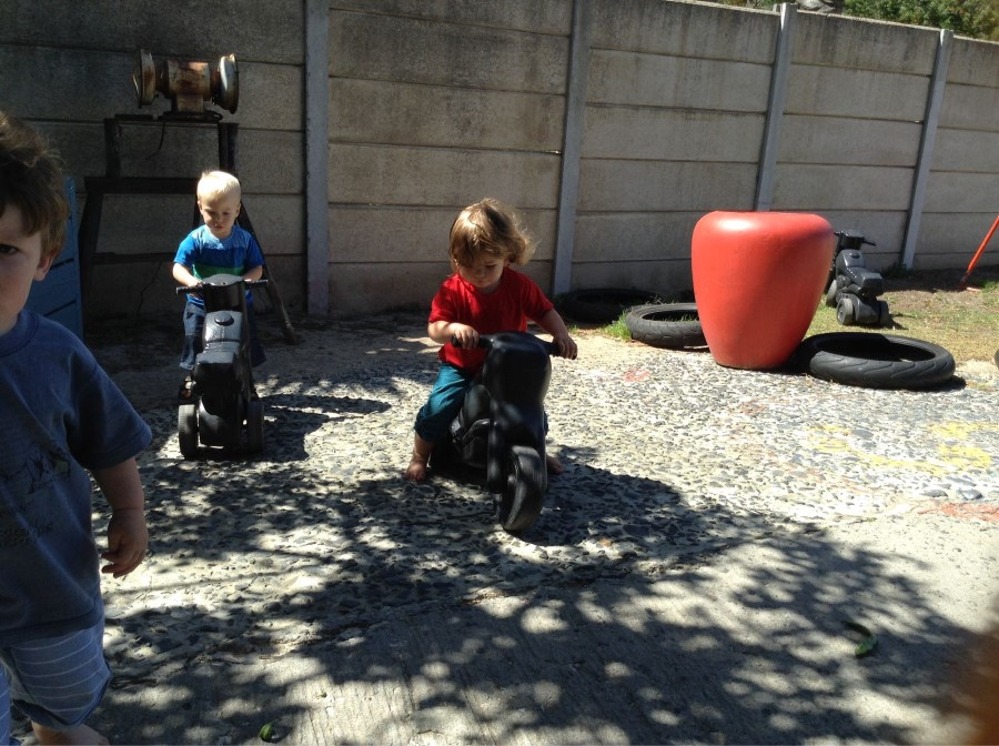 emily on kid push bike at baby steps daycare