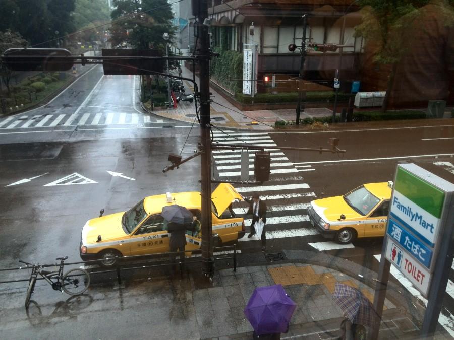 IMG_20141005_074035 yellow taxis in a wet yokohama street