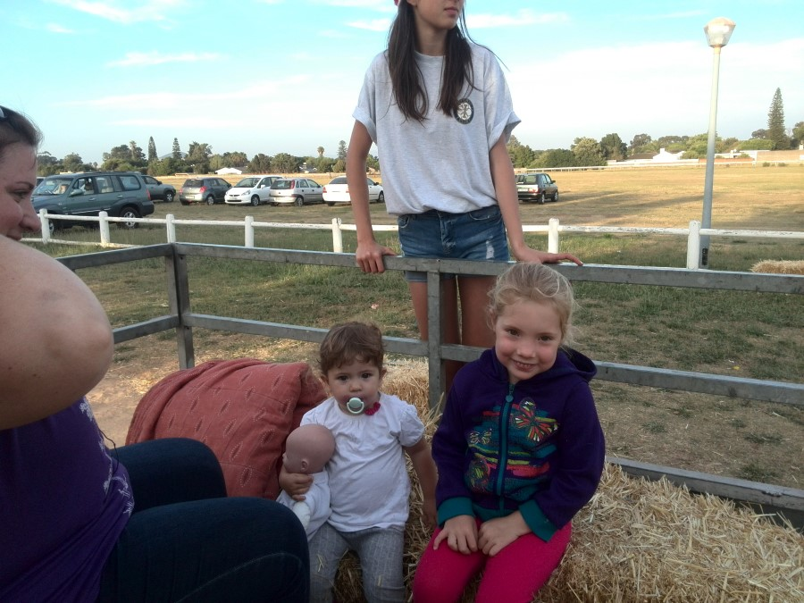 IMG_20151205_190150 jessica and emily ready for their trailer ride at oom piet's christmas party at durbanville race course