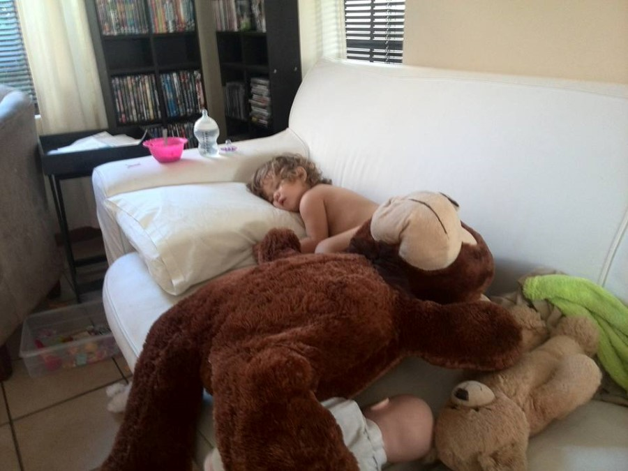 sick toddler emily sleeping on the couch with big monkey