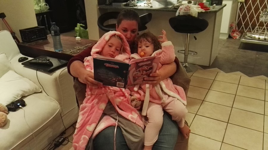 IMG_20160402_200757 chantelle reading to a tired out jessica and emily