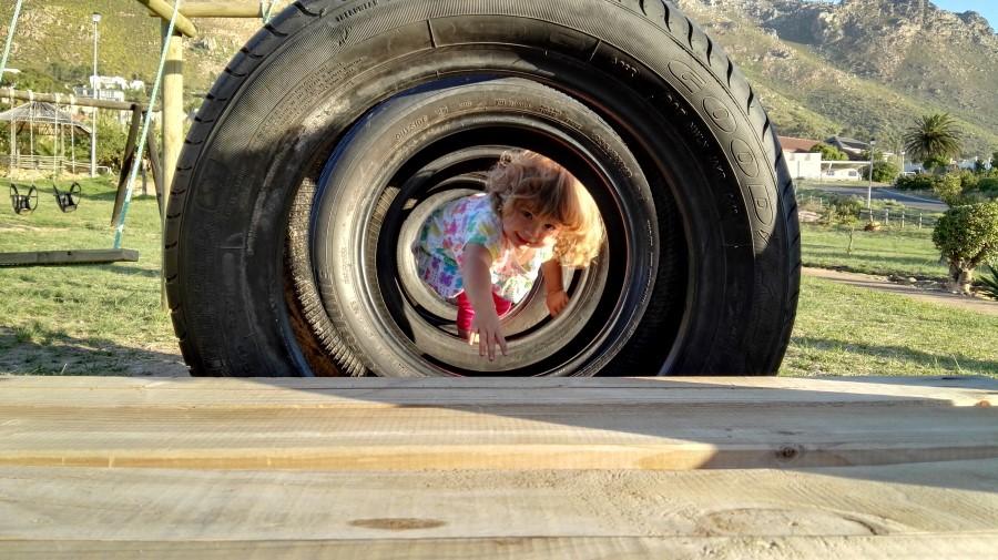 IMG_20160408_174138 emily in a car tyre at pollock park in gordon's bay