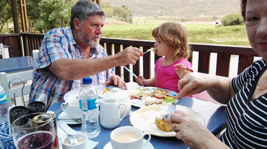 IMG_20160416_143117 monty feeding emily at the blue cow coffee shop and restaurant in barrydale