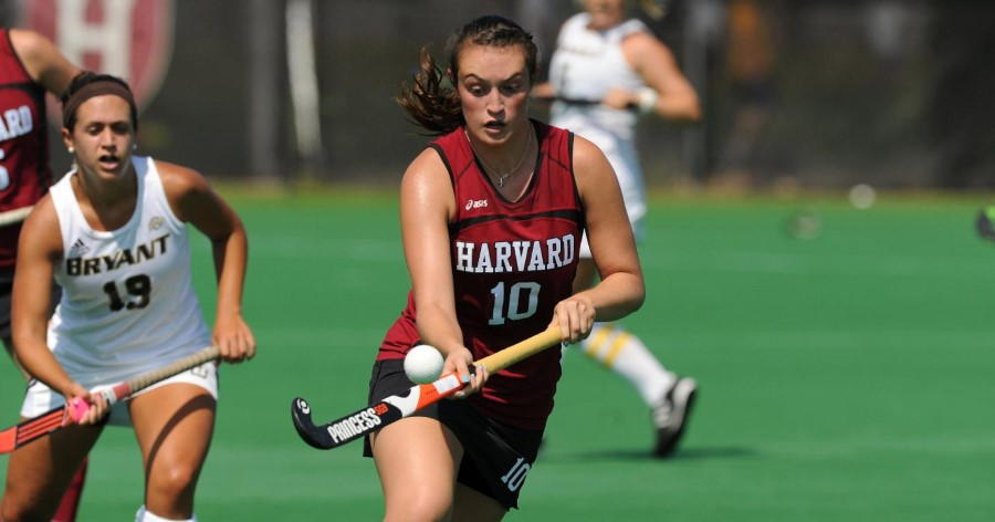field hockey girl juggling ball during game