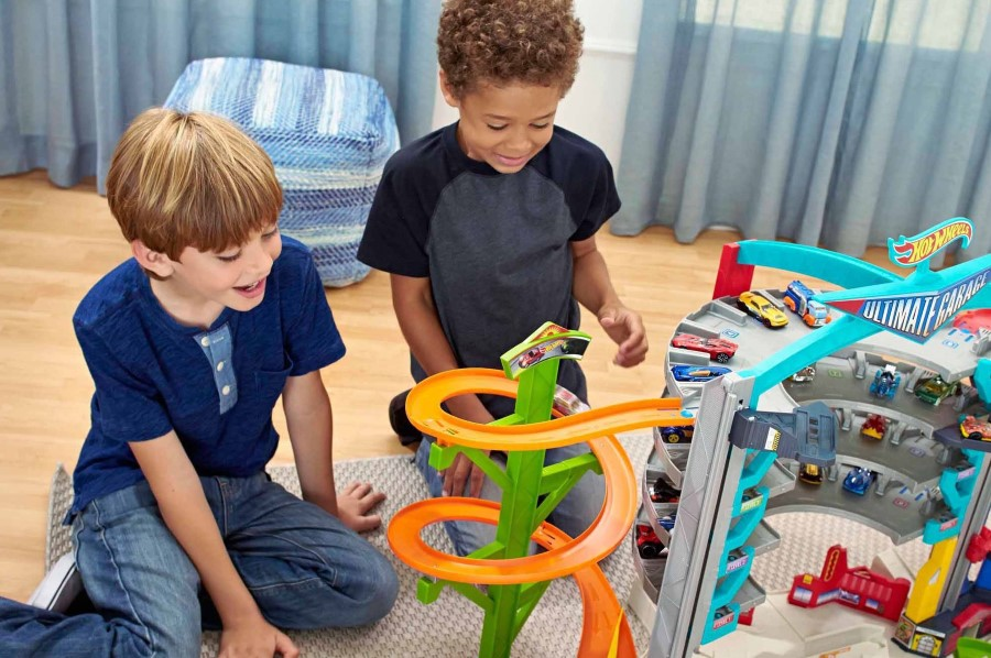 hot wheels ultimate garage being played with by two boys