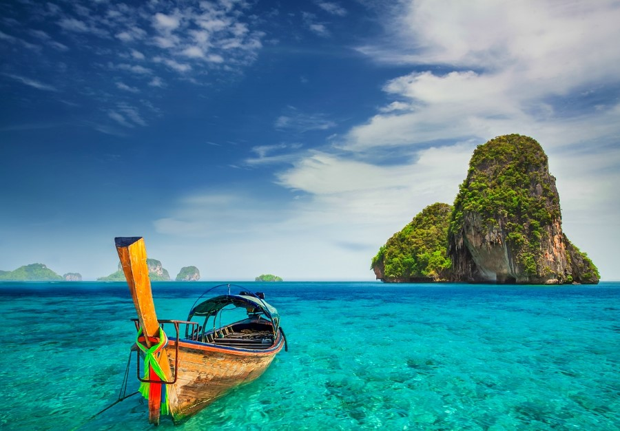 moored boat in crystal clear water on a beach at phuket, thailand